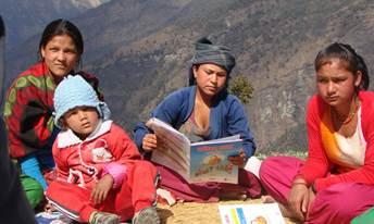 A group of women read outside