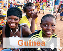 Three people celebrate in Guinea.