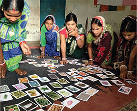 Women go through a card sorting exercise.