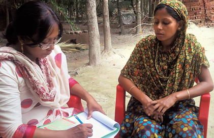 A woman talks with a health worker.