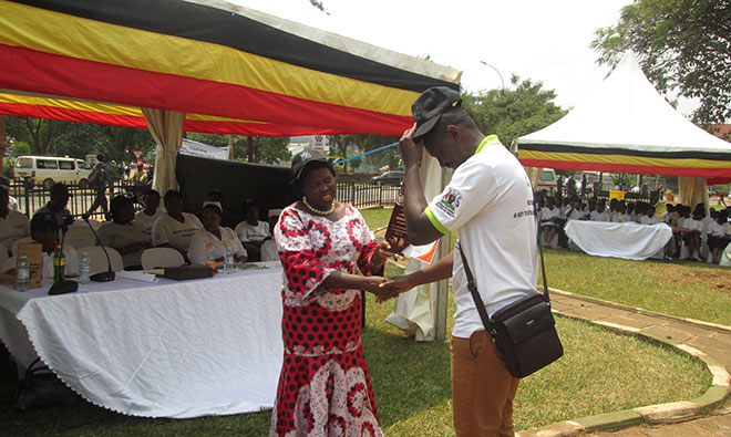 Hon. Dr. Moriku Joyce, the State Minister of Primary Health Care recognizes Moses Ssebale a SPRING representative during the national breastfeeding celebrations. SPRING played a critical role to organize the function.