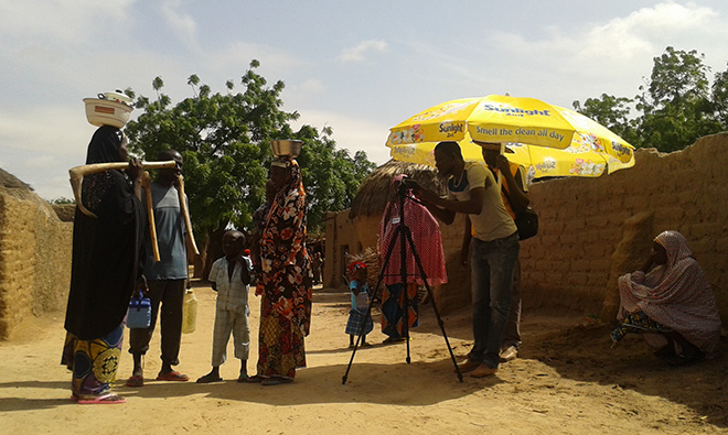 Photo of a group filming a community video.