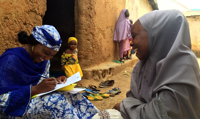 SPRING's Study Coordinator, Ms. Susan Adeyemi interviews a Community Volunteer from Kasuwan Magani Ward.