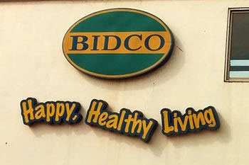 Sign on the gate of the BIDCO factory.