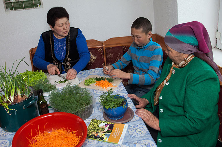 Photo of a family working with vegetables.