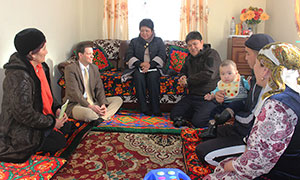 Nate Park, second from left, sits with Satybaldieva family, right, while SPRING volunteer Zuura Kydyralieva, left, talks to them about appropriate complementary feeding of their 11 month old son, Alinur. Mr. Park was joined by SPRING regional coordinator Dinara Boronbaeva, center, and USAID Osh representative Muhtar Irisov, center right.
