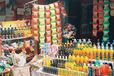 Photo of brightly colored snacks and drinks at a market. Credit: Lokendra Nath Roychoudhury