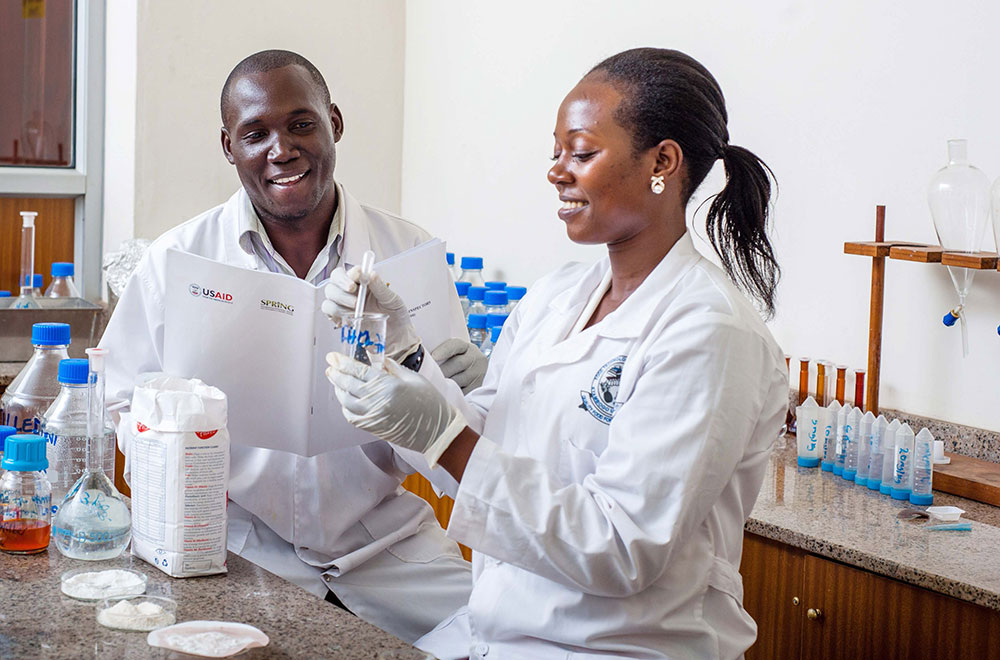 Thomas Okoth and Justine Nabuuma of Uganda Industrial Research Institute (UIRI) perform an iron spot test on maize flour, to determine if the flour is fortified.