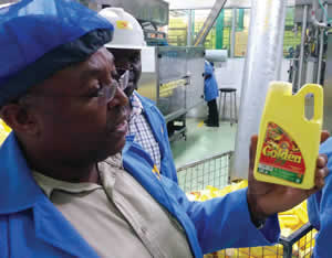 Vitamin A-fortified oil at a factory in Uganda.