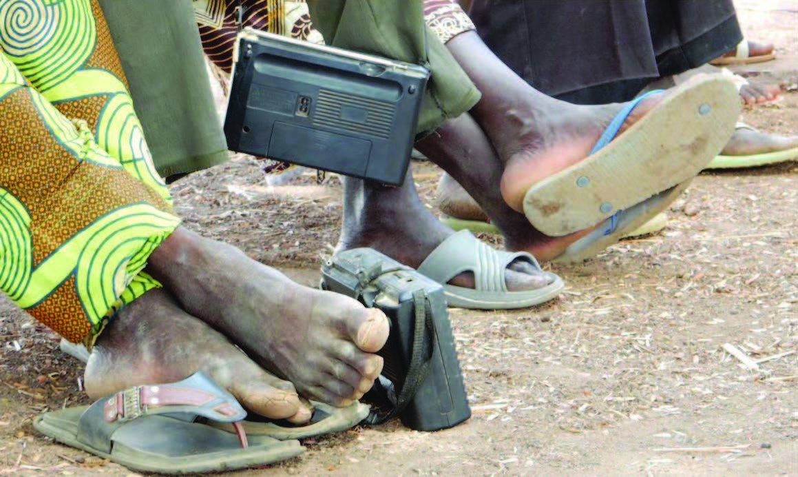 Close up image of camera resting at someone's feet.