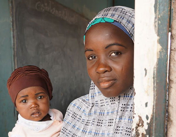 Saidi Abdullai and her 10-month old baby, Basharia. Saidi is a member of the Rahamamother-to-mother support group in Ningi village in Bauchi, Nigeria. Credit: Barry Chovitz, SPRING.
