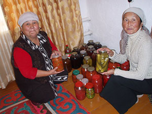 Jumgal women with their preserved vegetables