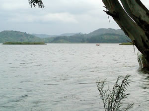 Photo of surrounding water and a sampled island village in Kisoro District (photo credit: Alexis D'Agostino, SPRING).