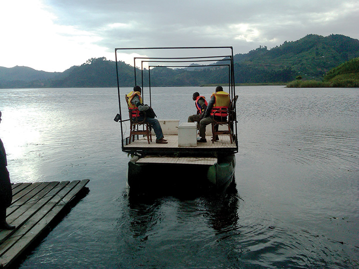 Photo of data collectors in life jackets and on a raft, traveling to an island village for carrying out the survey (photo credit: Alexis D'Agostino, SPRING).