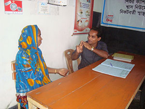A health assistant meets with a patient at Atakathi Community Clinic.