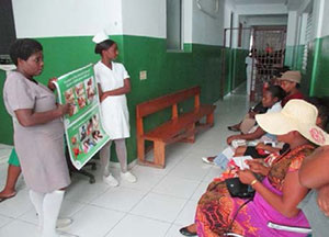 Nurses at the improved prenatal clinic lead group education about nutrition with pregnant women awaiting consultations.