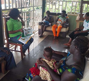 A nutrition officer meets with local mothers to discuss optimal feeding practices.