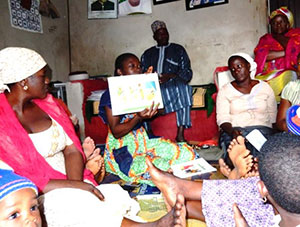 Parents attend a C-IYCF support group meeting in Benue State, Nigeria to learn about optimal nutrition practices.