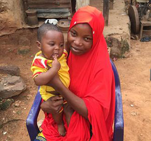 Zahila Abdulahi, who received help from a local feeding support group, shows off her healthy baby boy.
