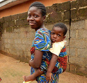 As a community volunteer, Mary Ohamije helps women like this member of a local C-IYCF support group adopt optimal infant and young child feeding practices.