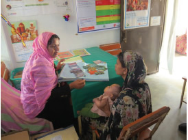 Jesmin Sultana counseling a lactating woman. Since receiving training, Jesmin confidently provides information on topics such as when and what to feed infants and how to tell if infants are receiving enough milk.