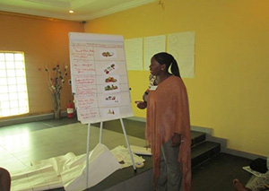 Photo of Priscilla making a presentation during her training