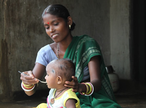 Women feeding her child complementary food
