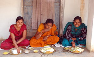 Women eating in the shade