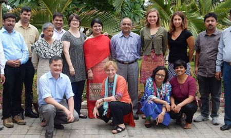 Partner members from LSHTM, DG, VARRAT, Ekjut, DCOR, and SPRING, pose for a photo together.