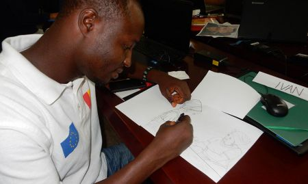 Tiekwei Souomou redraws his tracing in pen to strengthen lines and correct errors before scanning.