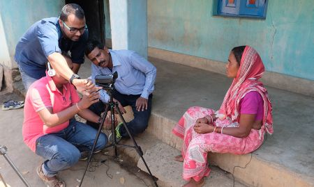 """The video production team captures the grandmother explaining that, """"When my daughter-in-law was pregnant we started planting all types of vegetables and as she ate variety of food and she could give birth to a healthy child"""". Photo credit: Sarah Hogan, 2017"""