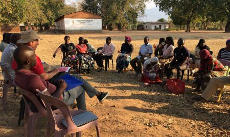 A focus group discussion in Malawi made up of farmers who grow orange-flesh sweet potatoes.