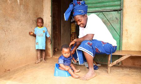 During a home visit, the team observed how a mother potty trains her child.