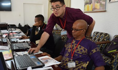 Andrew Cunningham of SPRING and Youssouf Ben Barry Oscar troubleshoot a Photoshop error. For many, this was their first experience with Photoshop.