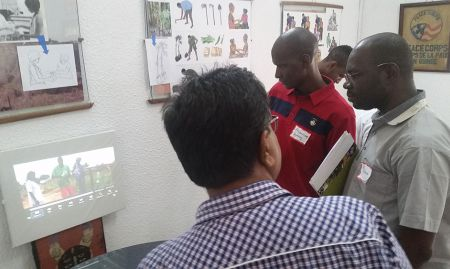 Digital Green's Dr. Nadagouda shares community video details to U.S. Peace Corps Guinea staff members N'Tossama Diarra and Dr Abdoulaye Barry.