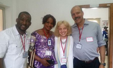 Phil Moses and Peggy Koniz-Booher from the SPRING SBCC team congratulate SPRING/Guinea staff Mamadou Hady Diallo and Hadja Mariama Konaté.