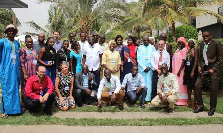 SPRING staff pose for a photo at the end of the close-out event in Dakar.