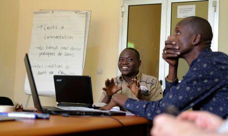 Staff participants explain their group work.