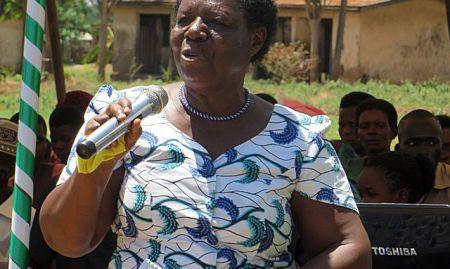 Hon. Florence Mutyabule, Area Women Member of Parliament, addresses the community members