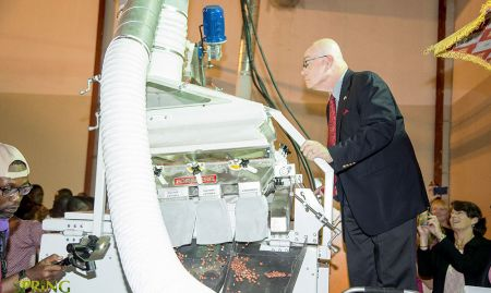 U.S. Ambassador Jackson taking a close look at how the nut roasting equipment operates.