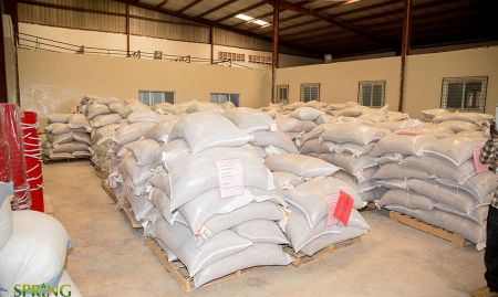 Packed sacks of groundnuts and other production ingredients.