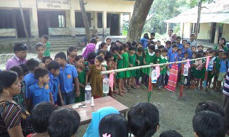 Crowd of children around some tippy taps
