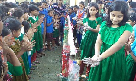 Girls demonstrating handwashing