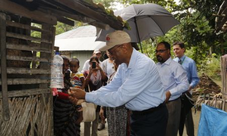 USAID Acting Administrator using a tippy tap