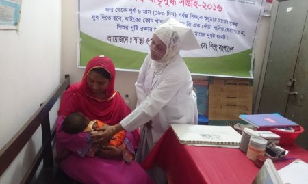 A woman breastfeeds at the breastfeeding corner at Abhaynagar upazila health complex in Bangladesh during a 2016 event.