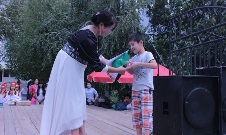 A boy performs a song about his mother.