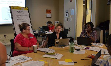 Participants discuss service integration models in a breakout session.