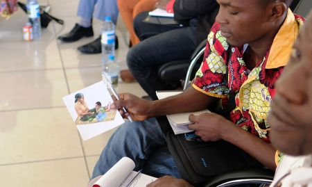 Participants discuss images depicting the first 1000 days of a child's life.