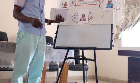 A participant, Diallo, examines how to break the cycle of malnutrition.