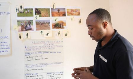 A participant, Bangouya, shares his group's work on agricultural technologies in the local rice value chain.